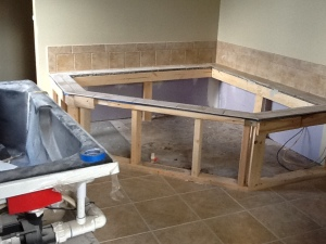 Tile completed around whirlpool tub